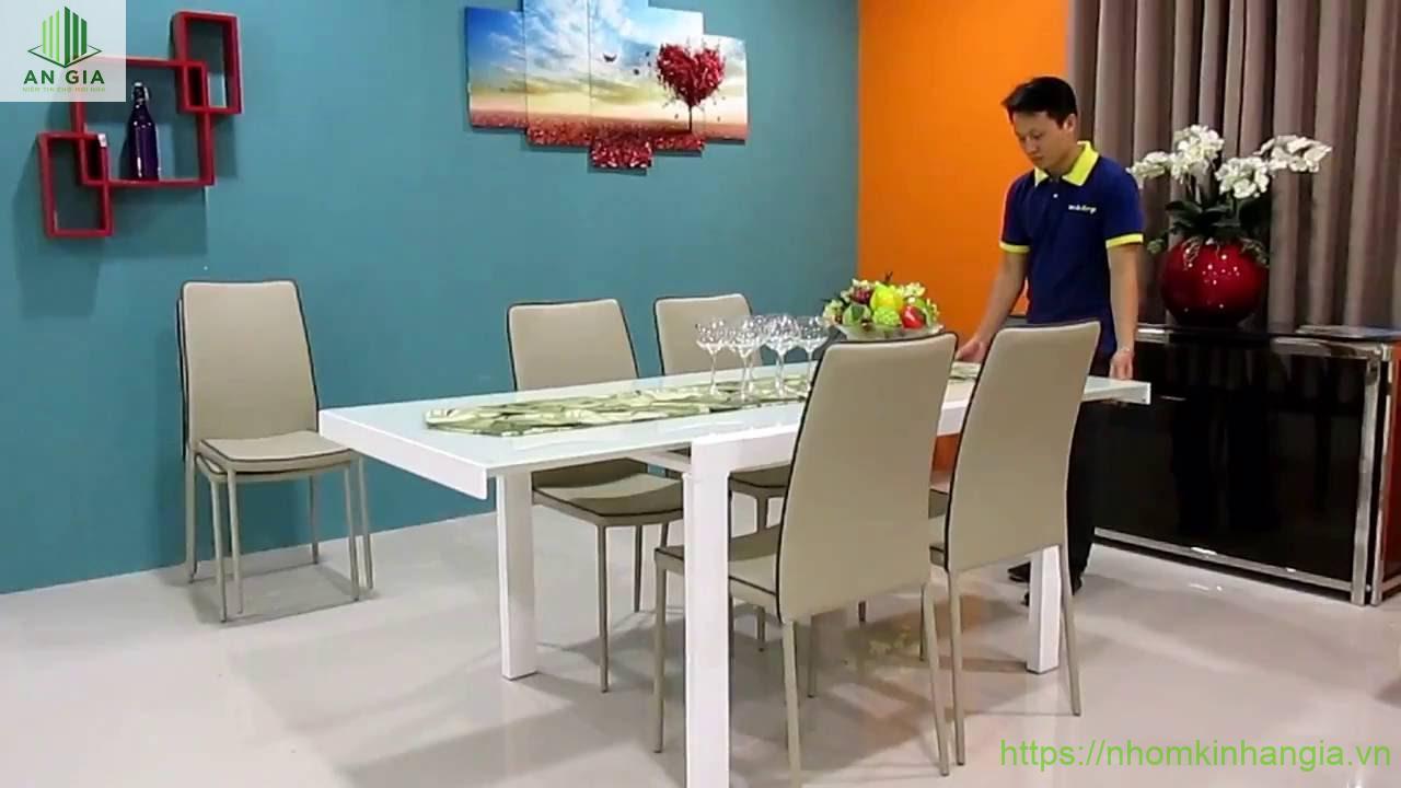 Mẫu 11: Bề mặt bàn từ kính cường lực trắng phối hợp cùng sắc xám của bộ ghế tạo nên sự trang nhã cho sản phẩm