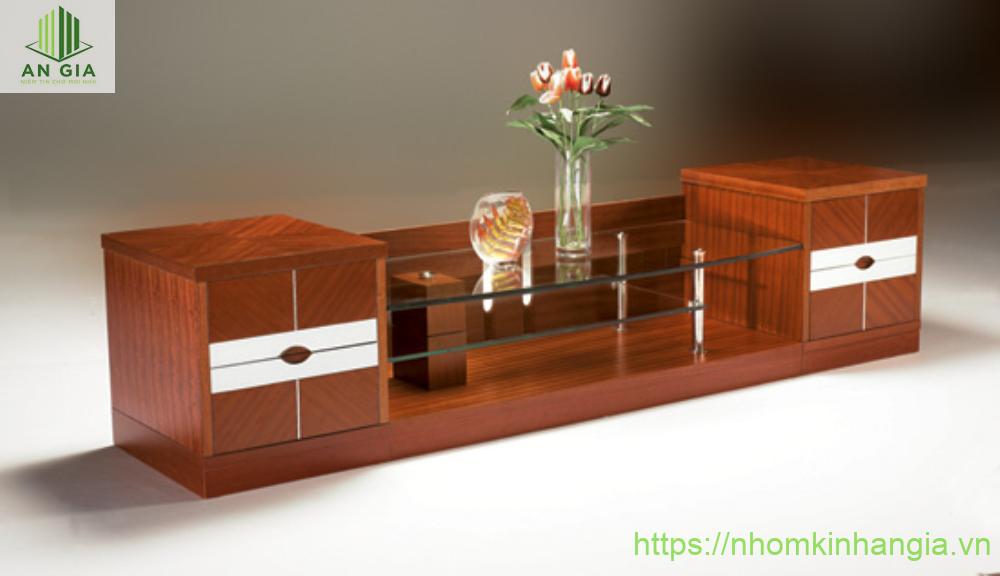 Mẫu 18: Thiết kế chính của bàn kính để tivi với vật liệu chính là gỗ được lắp đặt phần đặt tivi bằng kính cường lực